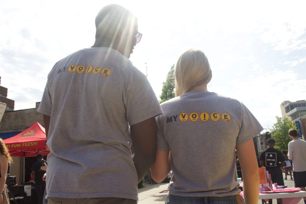two myvoice team members wearing their shirts