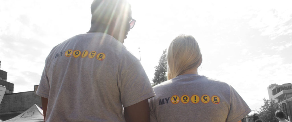 Two MyVoicers wearing MyVoice t-shirts