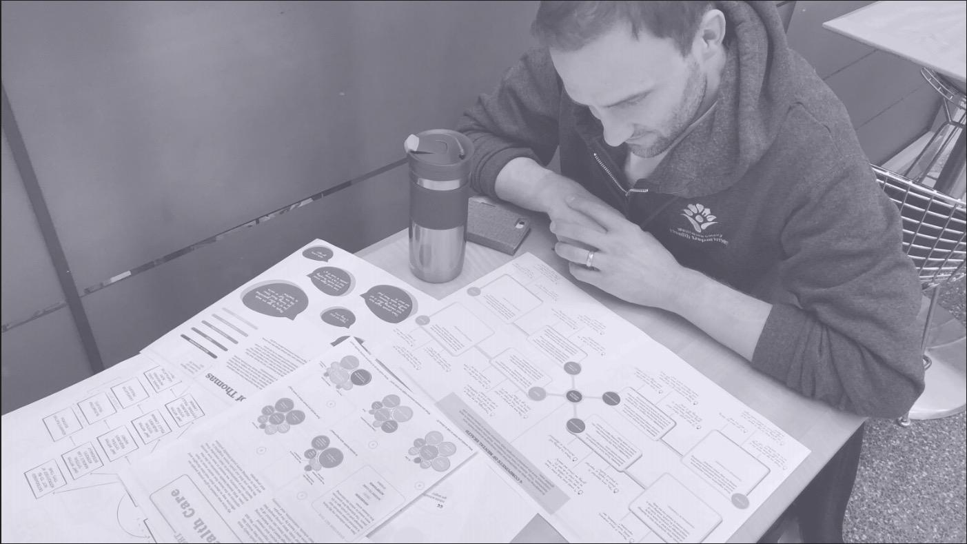 washtenaw health official examining prototypes