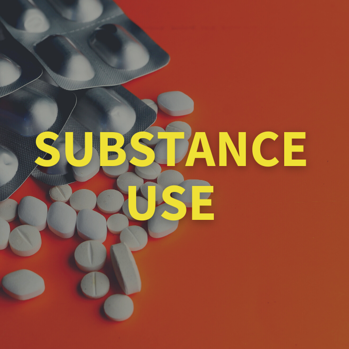 Substance use with background of white pills of different sizes pilled on an orange surface